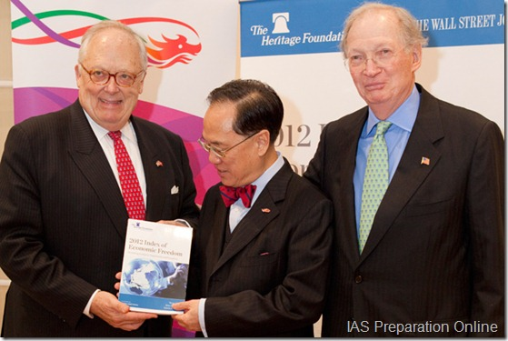 saunders-and-feulner-present-hon-tsang-with-index-2012